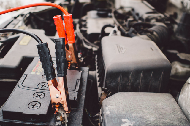 Jumper cables on a car battery